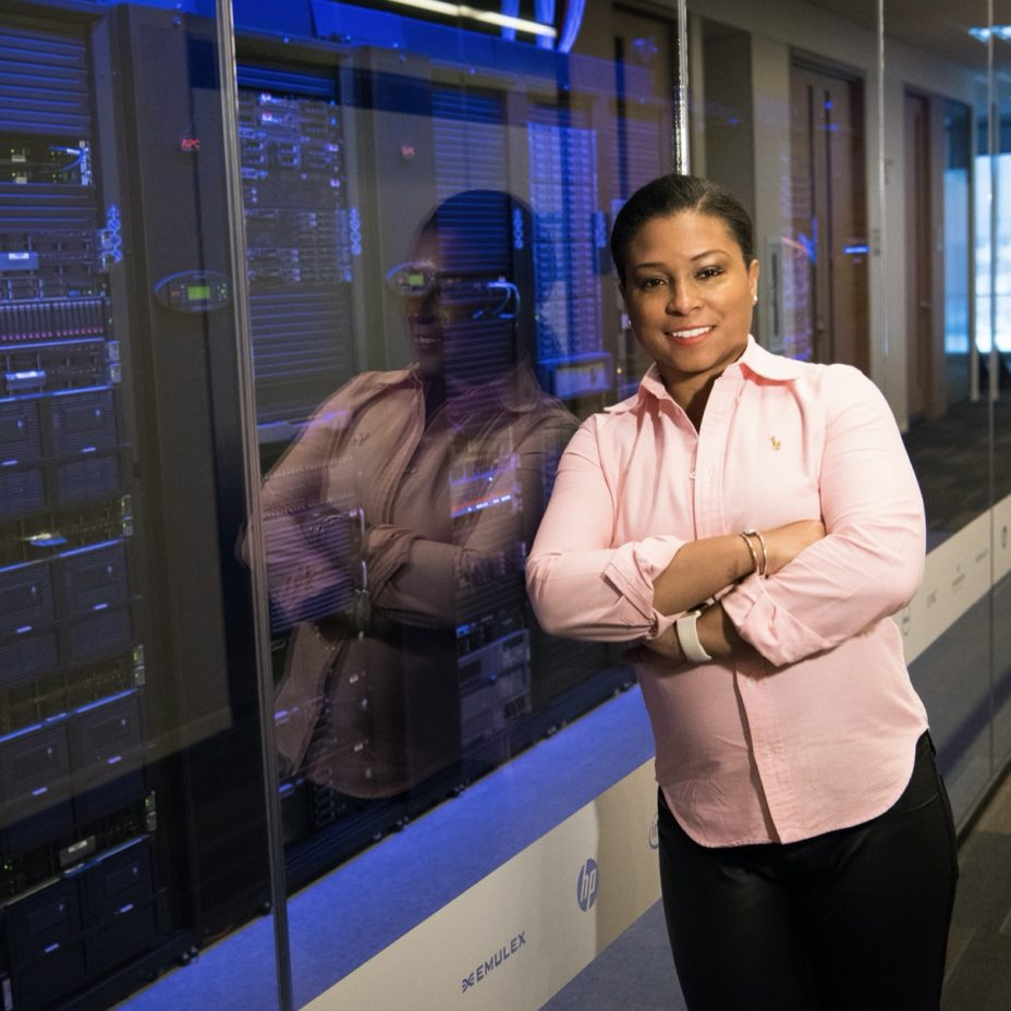 lady standing at computer servers
