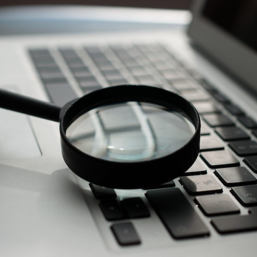 magnifying-glass-over-computer
