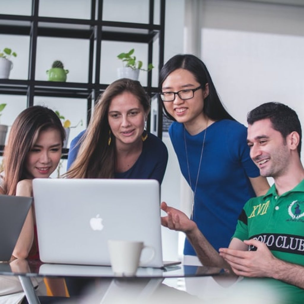 Workers looking at computer for Inbound Marketing Results